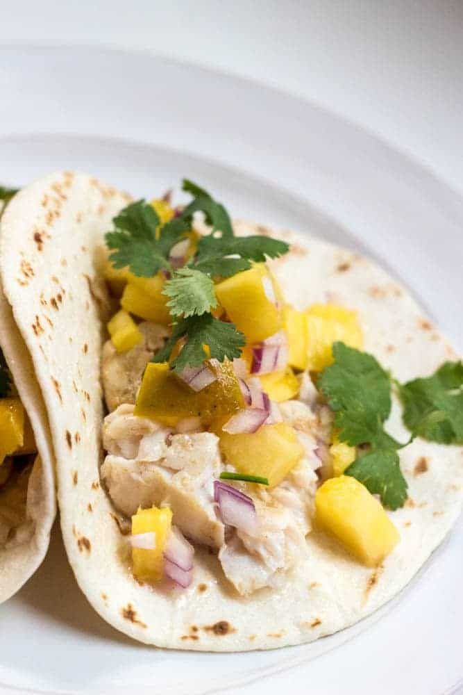 Grilled fish tacos with pineapple salsa dash of herbs for Pineapple sauce for fish