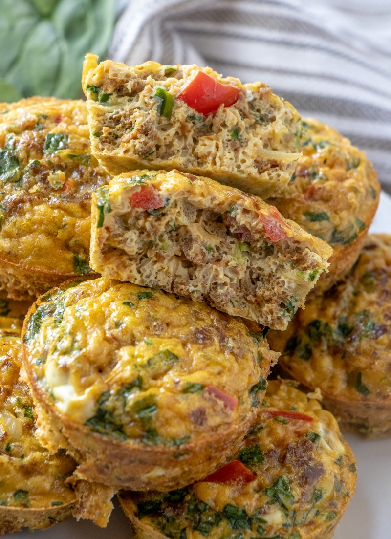 The turkey sausage and spinach mini quiches recipe showing one of the muffins broken in half.